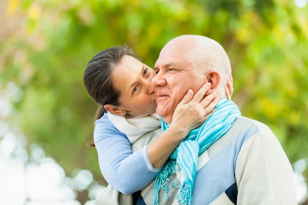 Couple Mature portrait of mature couple in autumn park photo | free download