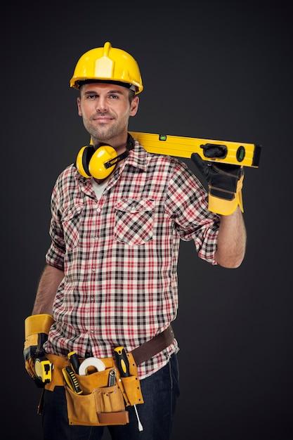 Портрет улыбающегося строителя Бесплатные Фотографии