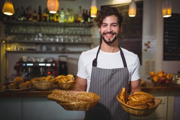 """Képtalálat a következőre: """"Portrait of waiter holding a basket of bread Free Photo"""""""