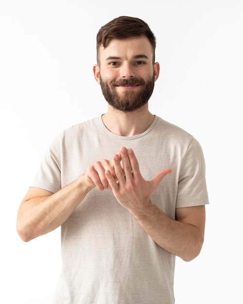 Портрет женщины, преподающей язык жестов Бесплатные Фотографии