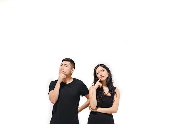 Portrait of pensive korean couple isolated on white Free Photo