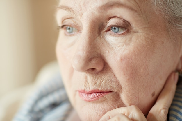Portrait of pensive old woman Free Photo