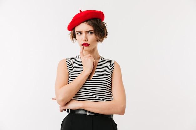 Portrait of a pensive woman wearing red beret Premium Photo