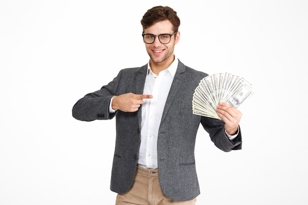 Portrait of pleased young man in eyeglasses and a jacket Free Photo