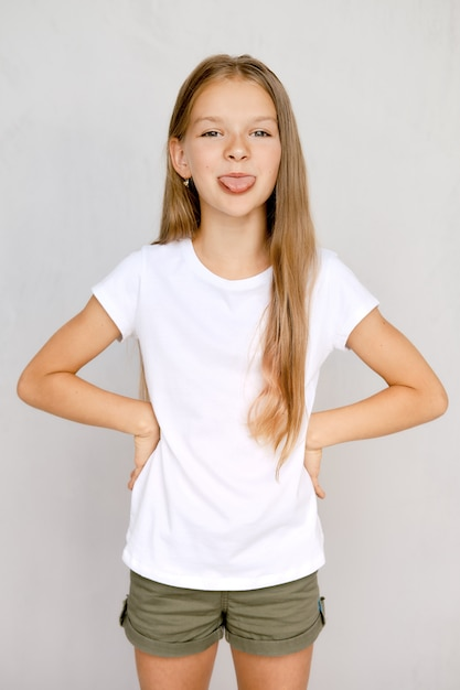 Portrait of positive teenager girl sticking out tongue Premium Photo