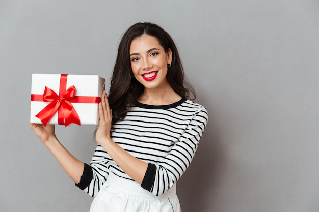 Portrait of a pretty girl holding present box Free Photo