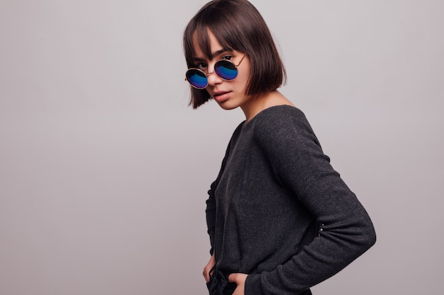 Portrait of pretty girl teenager in sunglasses isolated. Free Photo