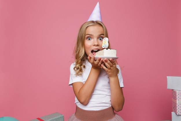 Portrait of a pretty little girl in birthday hat Free Photo