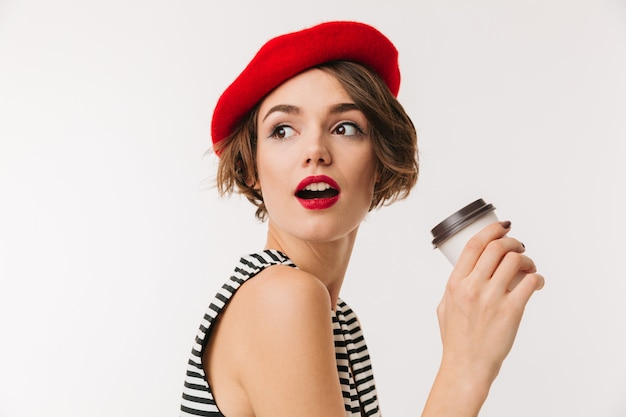 Portrait of a pretty woman wearing red beret Premium Photo