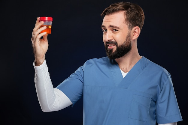 Portrait of a puzzled male doctor dressed in uniform Free Photo