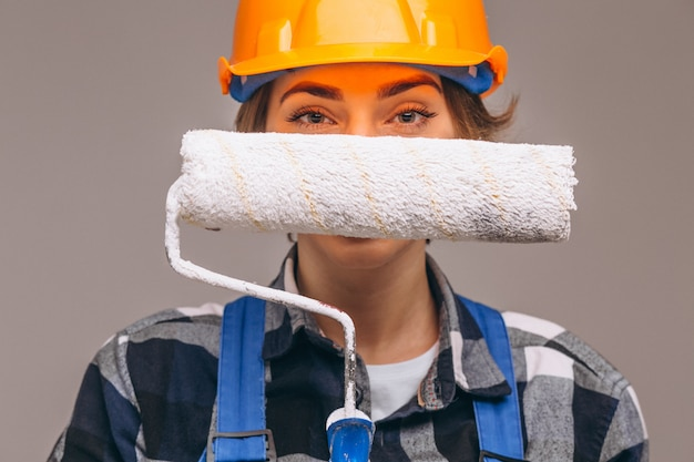 Portrait of repairer woman with painting roller isolated Free Photo