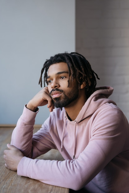 Premium Photo | Portrait of sad african american man sitting alone at home
