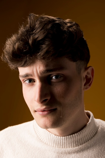 Portrait of sad young man Free Photo