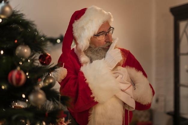 Portrait of santa claus delivering presents Free Photo
