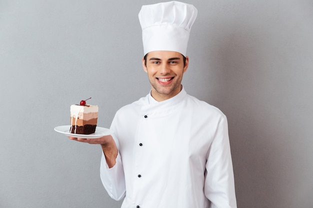 Portrait of a satisfied happy male chef Free Photo