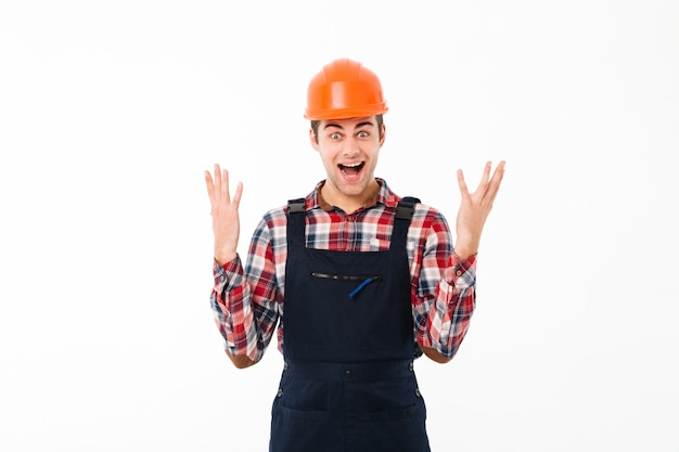 Portrait of a satisfied young male builder celebrating Free Photo