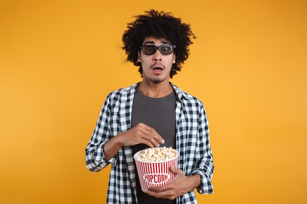 Portrait of a scared afro american man in 3d glasses Free Photo