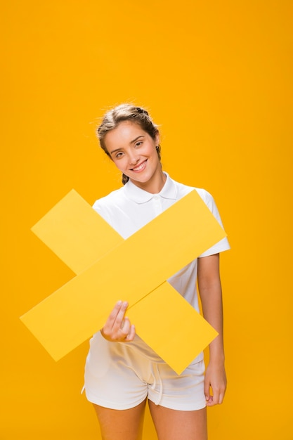 Portrait of a schoolgirl holding a cross Free Photo