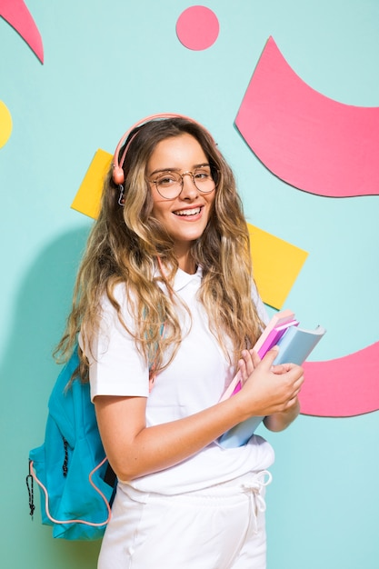 Portrait of schoolgirl on memphis style background Free Photo