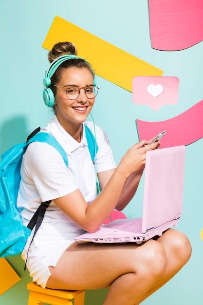 Portrait of schoolgirl studying with laptop Free Photo