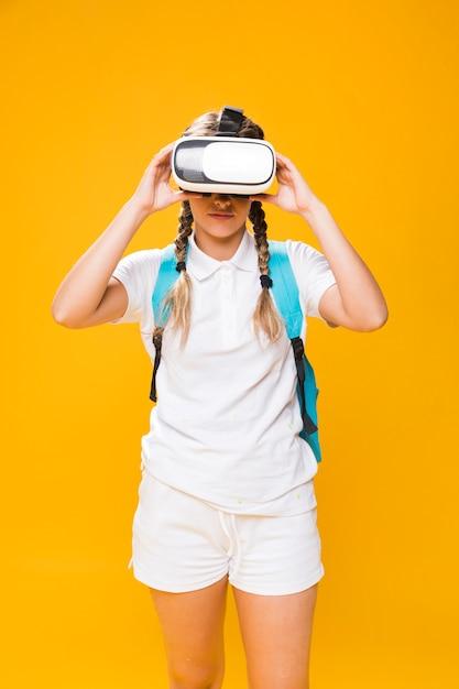 Portrait of schoolgirl with vr glasses Free Photo