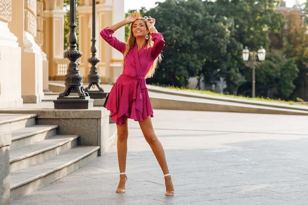 Portrait of seductive blond woman in elegant silk dress Free Photo