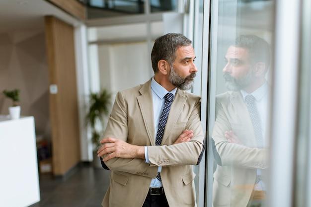 Portrait of senior businessman by the window Premium Photo