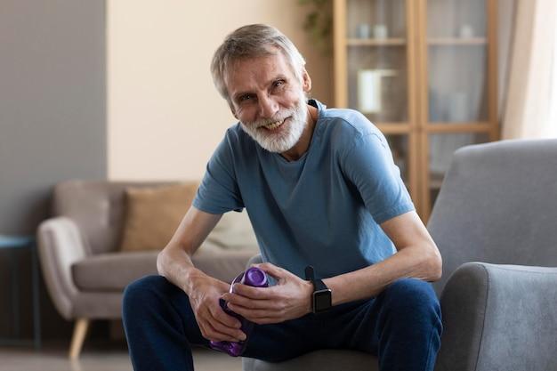 Portrait of senior man ready to train at home Free Photo
