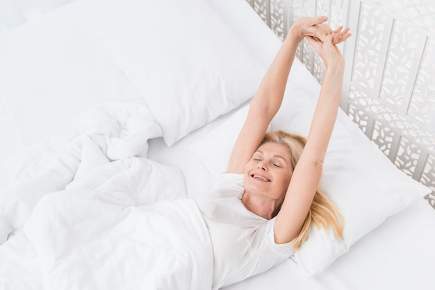 Portrait of senior woman waking up in the morning Free Photo