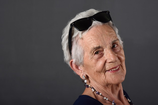 Portrait of a senior  woman with glasses on forehead Premium Photo