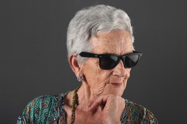 Portrait of a senior  woman with sunglasses Premium Photo