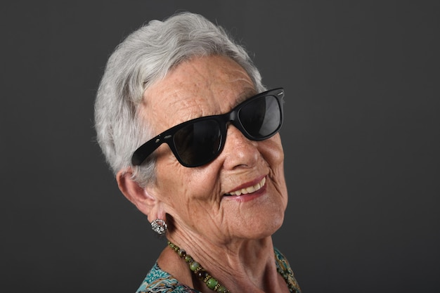 Portrait of a senior woman with sunglasses Premium Photo