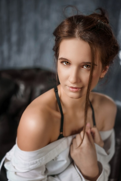 Portrait of sensual young beautiful woman in white shirt, seduction Premium Photo