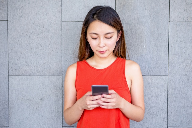 Portrait of serious asian girl using mobile phone Free Photo