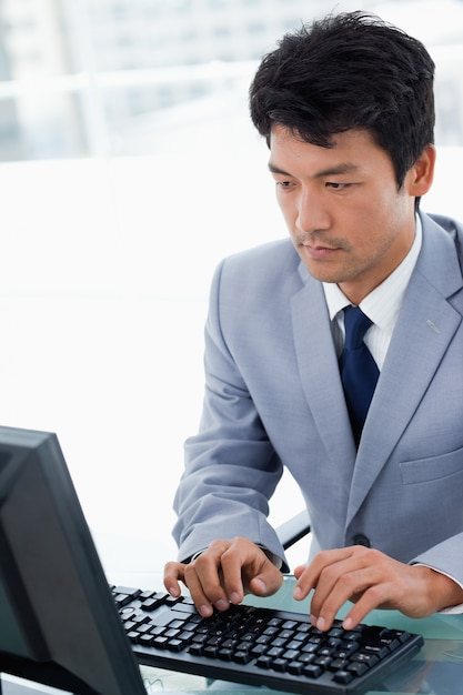 Portrait of a serious manager using a computer Premium Photo
