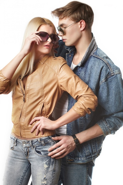 Portrait of sexy young hipster couple in studio Premium Photo
