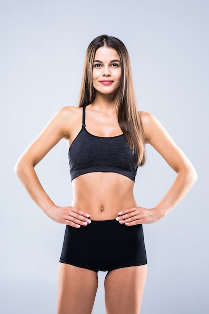Portrait of sexy young woman with her hands on hips Free Photo