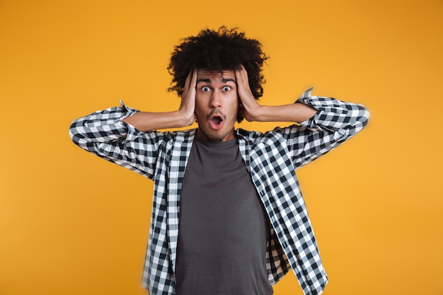 Portrait of a shocked astonished african man Free Photo
