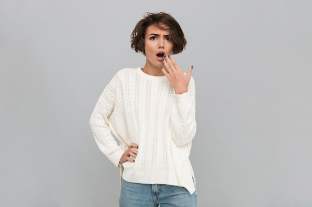 Portrait of a shocked woman in sweater Free Photo
