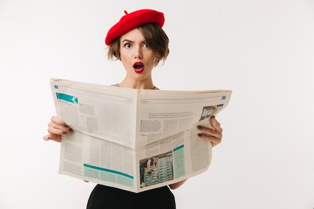 Portrait of a shocked woman wearing red beret Premium Photo