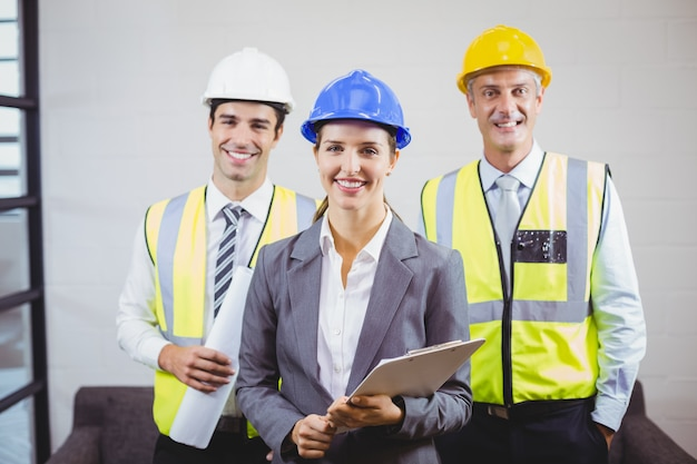 Portrait of smiling architects with clipboard Premium Photo