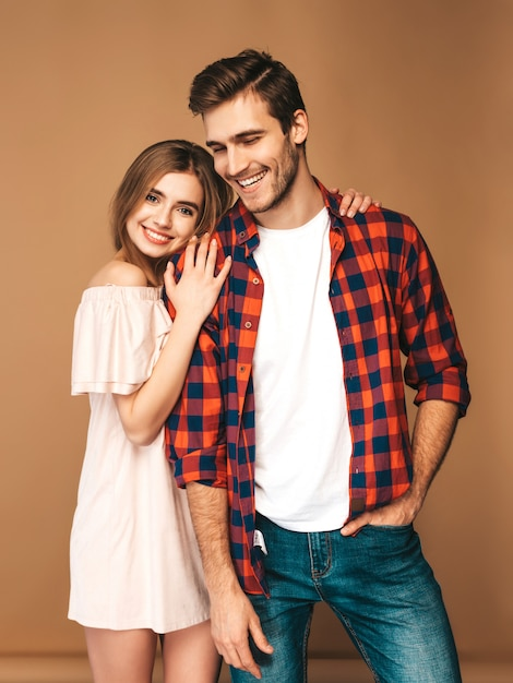 Portrait of smiling beautiful girl and her handsome boyfriend laughing. Free Photo