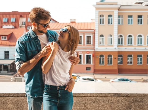 Portrait of smiling beautiful girl and her handsome boyfriend. woman in casual summer jeans clothes. Free Photo