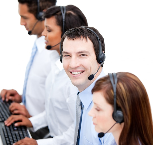 Portrait of smiling businessteam with an headset Premium Photo