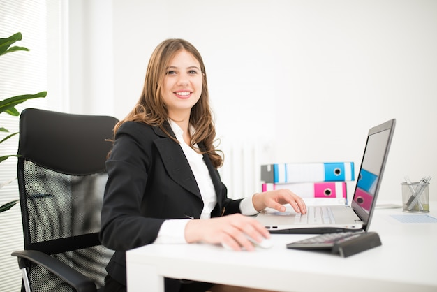 Portrait of a smiling businesswoman in her office Premium Photo