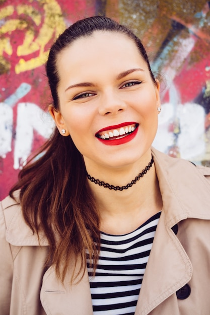 Portrait of a smiling emotional girl on a bright background Premium Photo