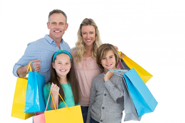 Portrait of smiling family with shopping bag Premium Photo