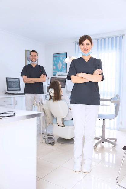 Portrait of smiling female and male dentist in clinic Free Photo