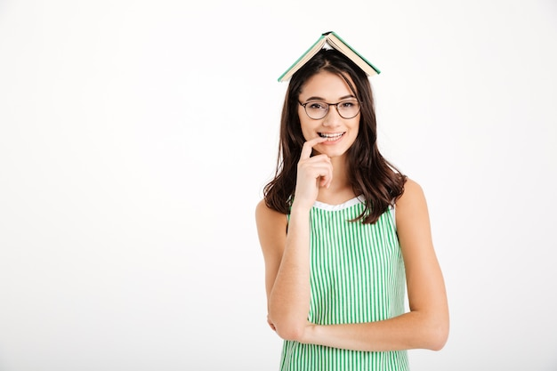 Portrait of a smiling girl in dress and eyeglasses Free Photo
