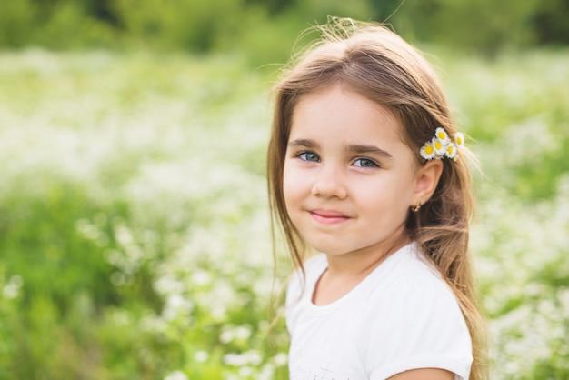 Portrait of smiling girl wearing flowers in head Free Photo